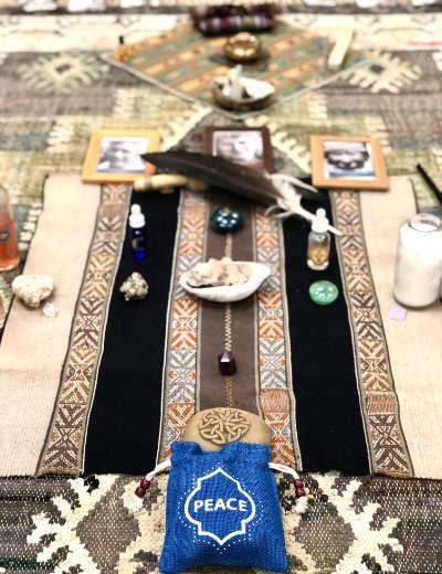 arrangement of ceremonial objects on wood floor